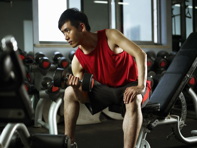 man-sitting-on-weight-bench-lifting-dumb-bells-royalty-free-image-1134418332-1557166788